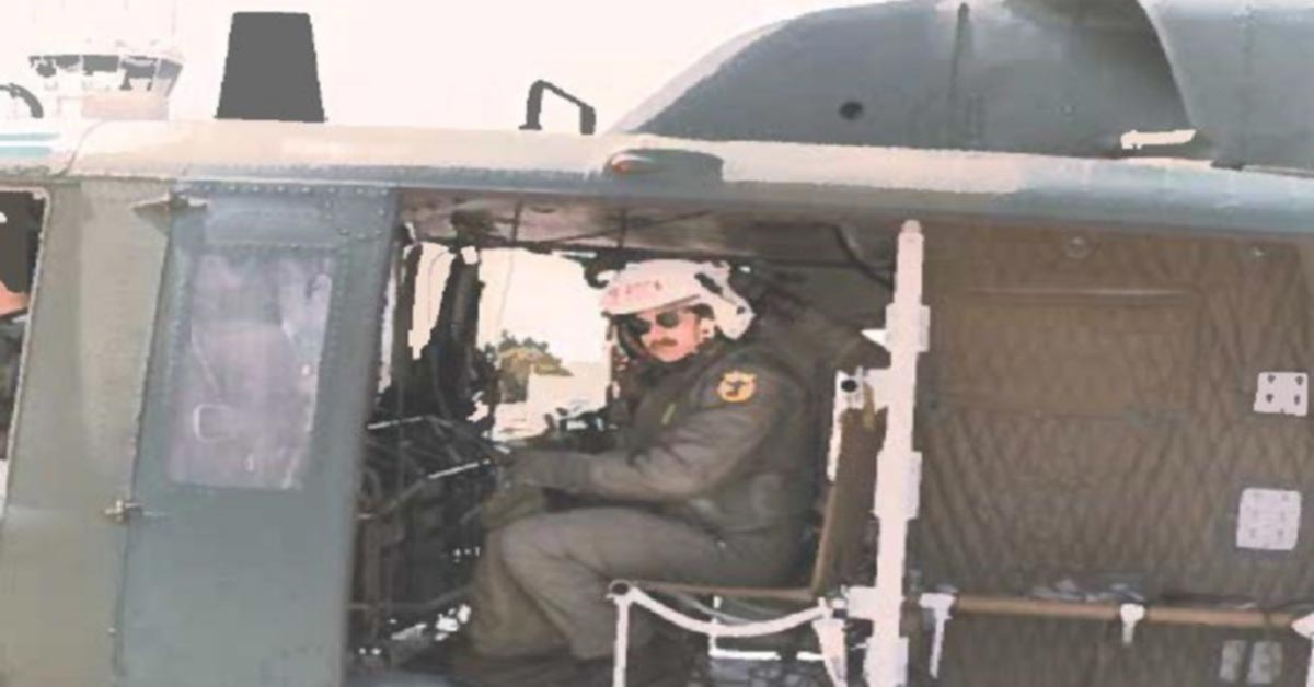 Dr. Ronald Christianson in a helicopter - U.S. Air Force veteran