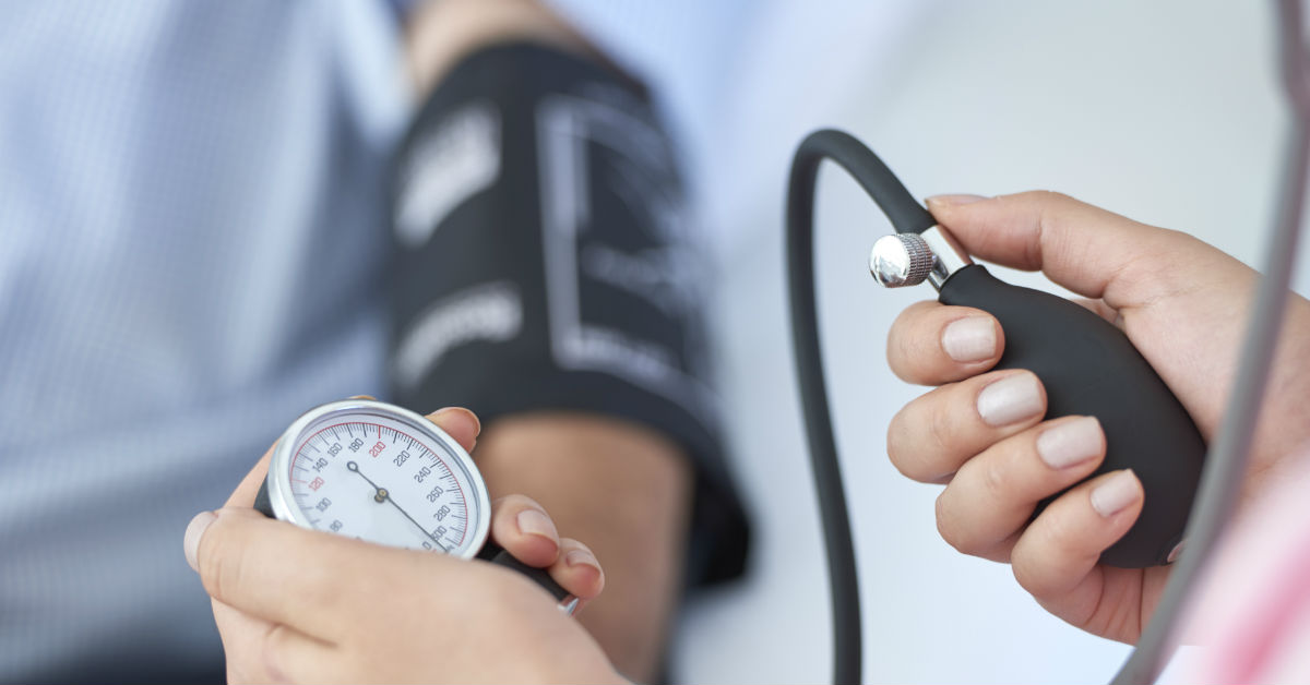 Taking patients blood pressure
