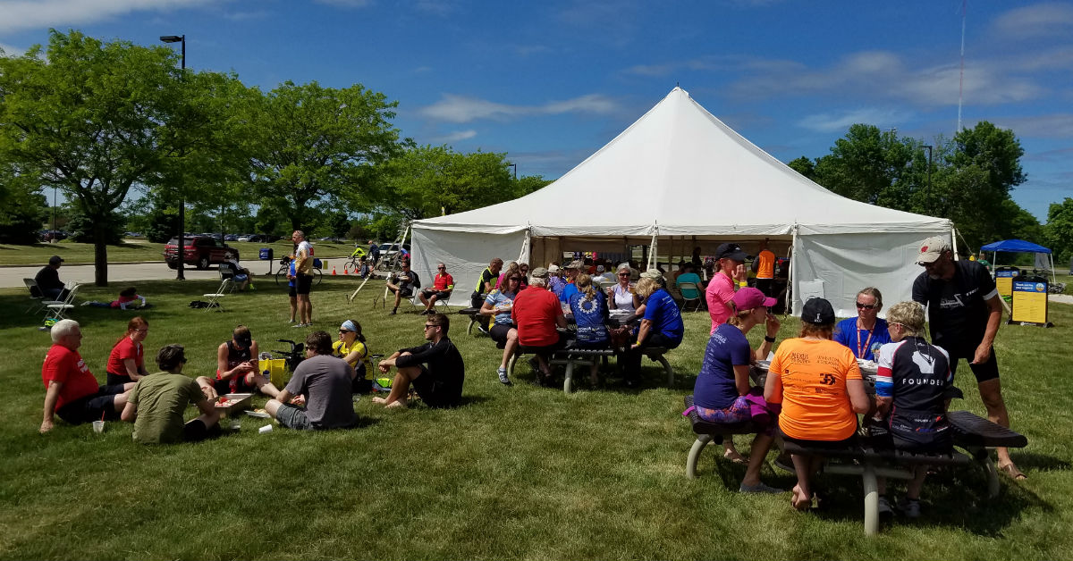 Riders enjoy a picnic-style meal after completing the BayCare Clinic Century Bayshore to Lakeshore