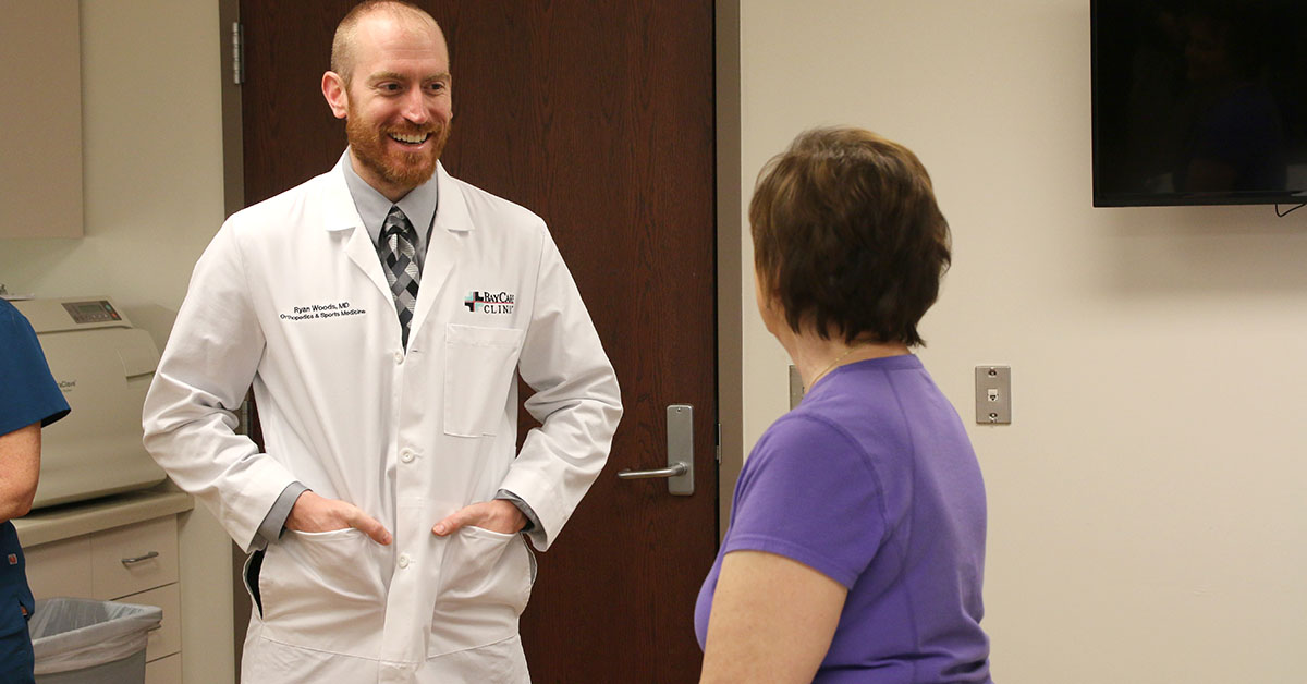 Dr. Ryan Woods talks with a patient