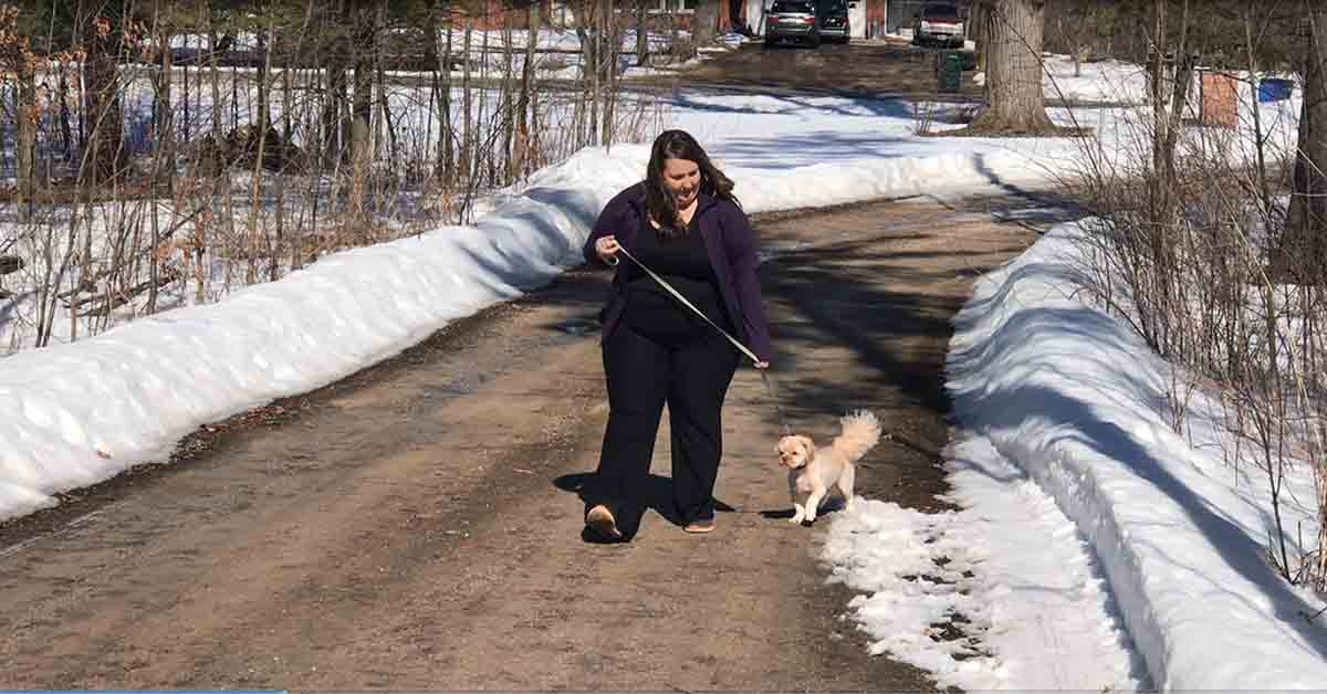 Anne Laurent walking her dog