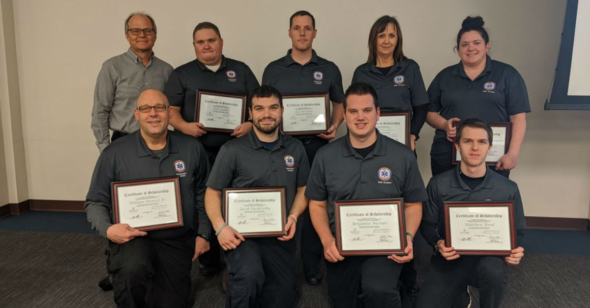 Eight NWTC EMS students and Dr. Christopher Sorrells