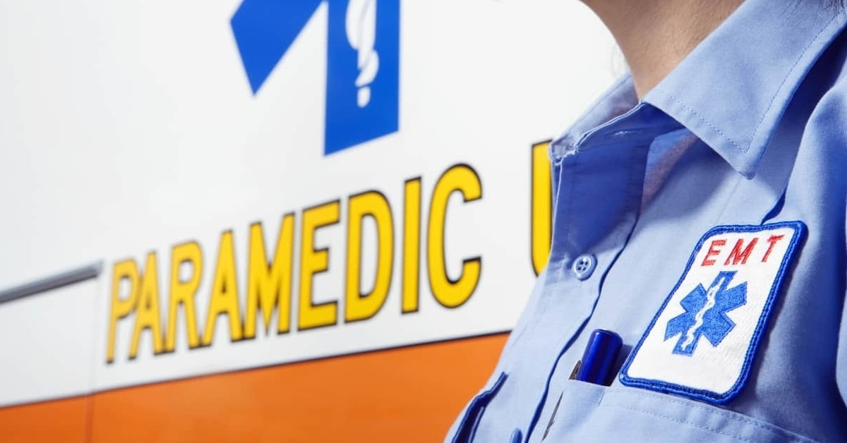 Photo of an emergency medical services worker near an ambulance