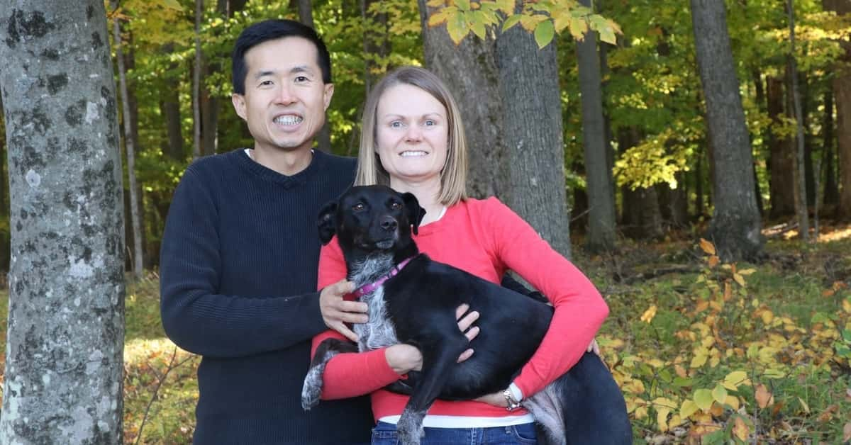 Dr. Wei-Chuan Wang of BayCare Clinic poses with his wife and dog